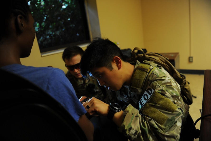 Staff Sgt. Paoloarnold Pineda, right, and Airman 1st Class Lawrence Gress, explosive ordnance disposal technicians with the 1st Special Operations Civil Engineering Squadron, investigate a bomb tied to a hostage during an exercise at Hurlburt Field, Fla., June 21, 2017. EOD technicians are trained to detect, disarm, detonate and dispose of explosive threats as safely as possible. (U.S. Air Force photo by Airman 1st Class Isaac O. Guest IV)