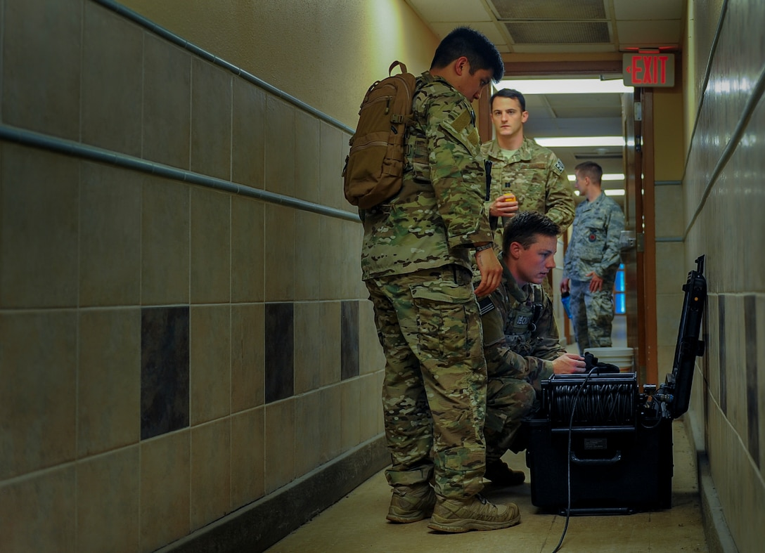 Explosive ordnance disposal technicians with the 1st Special Operations Civil Engineering Squadron operate an X-Ray machine during a hostage exercise at Hurlburt Field, Fla., June 21, 2017. This machine allows technicians to investigate explosives during bomb threat scenarios. The exercise placed EOD technicians through real-world situations, testing their abilities in disarming bombs and ensuring their readiness for global operations. (U.S. Air Force photo by Airman 1st Class Isaac O. Guest IV)