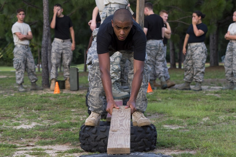 A Junior ROTC cadet lays a plank down to form a makeshift bridge between two tires during a team-building exercise at Hurlburt Field, Fla., June 26, 2017. More than 50 JROTC cadets from five local high schools engaged in a variety of team-building and leadership skill-developing exercises during a Summer Leadership School trip to Hurlburt Field, June 26 – 30. (U.S. Air Force photo by Staff Sgt. Victor J. Caputo)