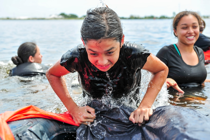 A Junior ROTC cadet pulls herself into a life raft during survival, evasion, resistance and escape training at Hurlburt Field, Fla., June 29, 2017. More than 50 cadets from five local high schools attended the week-long Summer Leadership School course at Hurlburt Field, where they learned about teamwork, leadership and life in the military. (U.S. Air Force photo by Staff Sgt. Victor J. Caputo)