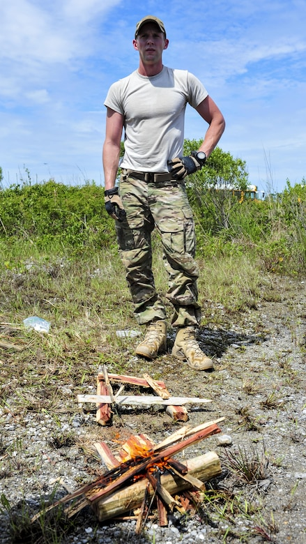 Staff Sgt. Casey Blackmon, a survival, evasion, resistance and escape specialist with the 1st Special Operations Support Squadron, explains fire-making principals to Junior ROTC cadets at Hurlburt Field, Fla., June 29, 2017. More than 50 cadets from five local high schools attended a Summer Leadership School course at Hurlburt Field, where they learned about leadership, teamwork and life in the military. (U.S. Air Force photo by Staff Sgt. Victor J. Caputo)