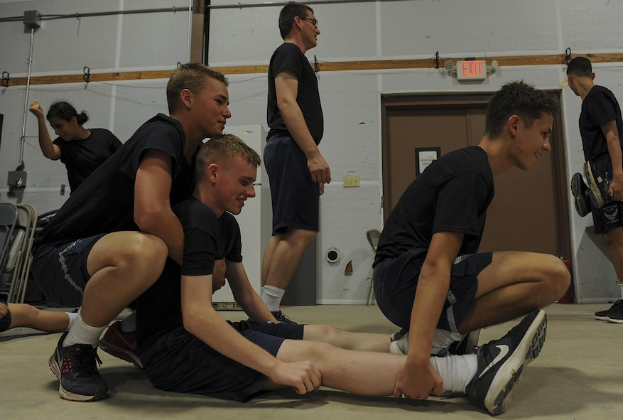 "Junior ROTC cadets practice the ""before and after"" carry while learning patient movements at Hurlburt Field, Fla., June 29, 2017. The 1st Special Operations Aerospace Medicine Squadron paired with more than 50 cadets to teach the basics of self-aid and buddy care during a Summer Leadership Course at Hurlburt Field. (U.S. Air Force photo by Airman 1st Class Rachel Yates)"