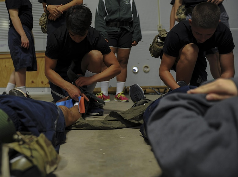 Junior ROTC cadets practice applying splints to broken limbs during Summer Leadership School at Hurlburt Field, FLa., June 29, 2017. Cadets were given a crash-course on how to administer life-saving care on the battlefield, such as quickly stabilizing patients and getting them out of harm's way. (U.S. Air Force photo by Airman 1st Class Rachel Yates)