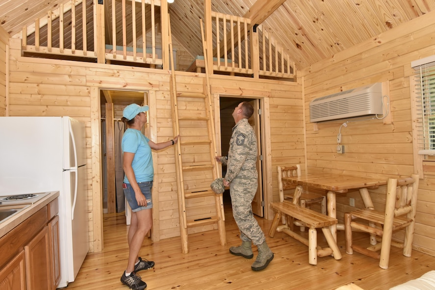 Participants take a tour of a cabin during the Dogwood Ridge recreation area grand opening and ribbon cutting ceremony June 20, 2017 at Arnold Air Force Base. (U.S. Air Force photo/Rick Goodfriend)