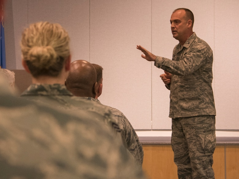 Col. Edward Vaughan, 156th Airlift Wing commander, speaks to audience members during a Lesbian, Gay, Bisexual and Transgender Pride Month special observance titled 'LGBT: I am an American Airman' at Joint Base Andrews, Md., June 29, 2017. The pride month is a stance against discrimination and violence toward the LGBT community by promoting equal rights, increasing visibility as a social group, and celebrating sexual diversity and gender variance. (U.S. Air Force photo by Airman 1st Class Valentina Lopez)
