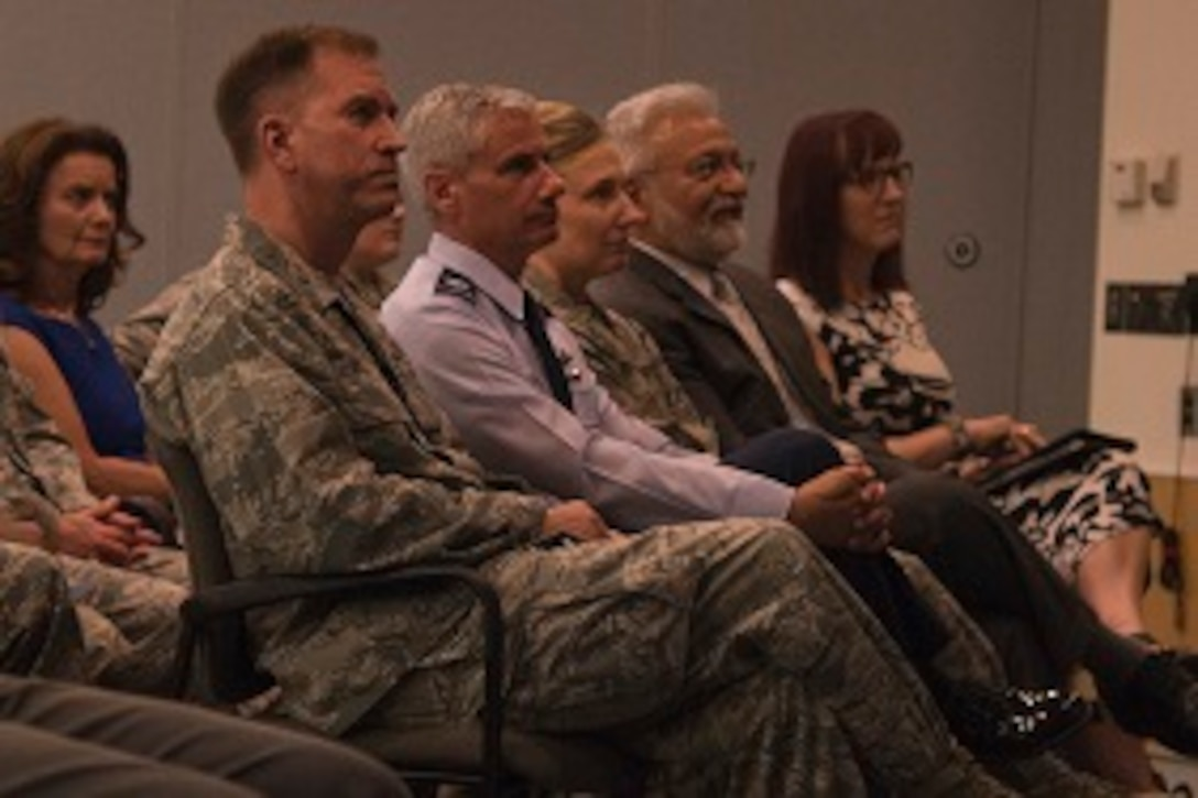 Audience members watch a video about Capt. David Schonberg, 113th Wing personnel officer, during a Lesbian, Gay, Bisexual and Transgender Pride Month special observance titled 'LGBT: I am an American Airman' at Joint Base Andrews, Md., June 29, 2017. The video highlighted Schonberg's life, experience and extraordinary contributions as an openly gay military member. (U.S. Air Force photo by Airman 1st Class Valentina Lopez)