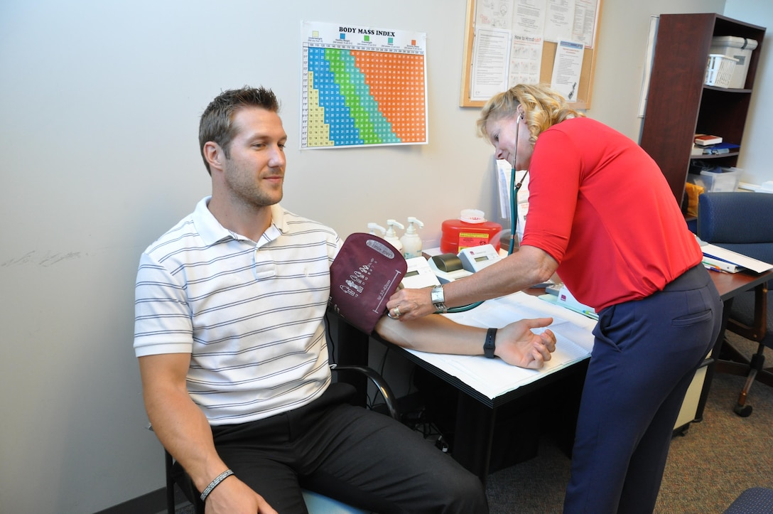 Drew Kuesel had his cholesterol checked recently by Karen McGinnis, health promotion specialist with Civilian Health Promotion Services. (U.S. Air Force photo/W. Eugene Barnett)