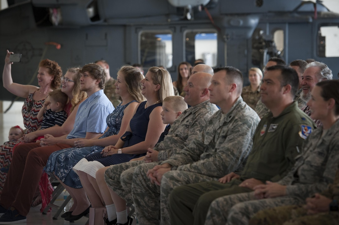 Family and friends watch and laugh during a promotion ceremony, June 28, 2017, at Moody Air Force Base, Ga. During the ceremony, then Maj. Christopher Dunston, 723d Aircraft Maintenance Squadron commander, promoted to lieutenant colonel and his younger cousin, then Senior Master Sgt. Brandon Dunston, 74th Aircraft Maintenance Unit superintendent, promoted to chief master sergeant. (U.S. Air Force photo by Airman 1st Class Lauren M. Sprunk)