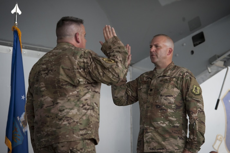 Col. Stephen Scherzer, 52d Maintenance Group commander, Spangdalhlem Air Base, Germany, administers the oath of office to Lt. Col. Christopher Dunston, 723d Aircraft Maintenance Squadron commander, during a promotion ceremony, June 28, 2017, at Moody Air Force Base, Ga. Scherzer traveled overseas to officiate the ceremony in which Chris promoted to lieutenant colonel and his younger cousin, then Senior Master Sgt. Brandon Dunston, 74th Aircraft Maintenance Unit superintendent, promoted to chief master sergeant. (U.S. Air Force photo by Airman 1st Class Lauren M. Sprunk)