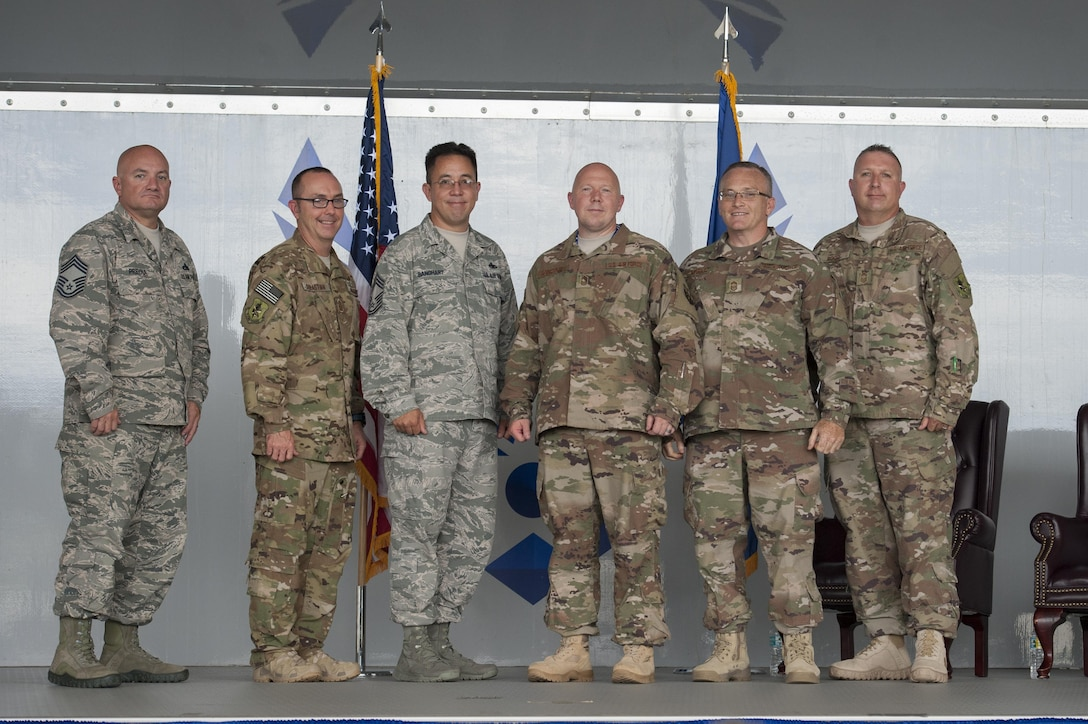 Moody Chiefs pose for a photo during a promotion ceremony, June 28, 2017, at Moody Air Force Base, Ga. During the ceremony, then Maj. Christopher Dunston, 723d Aircraft Maintenance Squadron commander, promoted to lieutenant colonel and his younger cousin, then Senior Master Sgt. Brandon Dunston, 74th Aircraft Maintenance Unit superintendent, promoted to chief master sergeant. (U.S. Air Force photo by Airman 1st Class Lauren M. Sprunk)