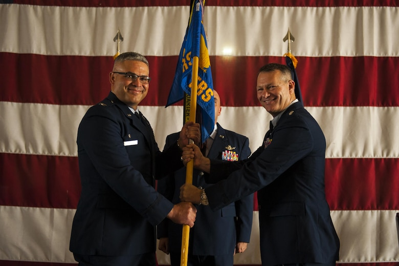 U.S. Air Force Lt. Col. Robert Kammerer, 316th Training Squadron Commander, receives the unit guideon from Col. Alejandro Ganster, 17th Training Group Commander, during the 316th TRS Change of Command at the Fire Academy high bay on Goodfellow Air Force Base, Texas, June 30, 2017. The change of command ceremony is a time honored military tradition that signifies the orderly exchange of authority.  (U.S. Air Force photo by Senior Airman Scott Jackson/Released)