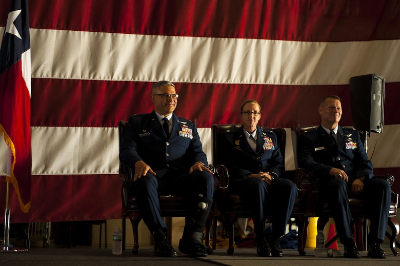 U.S. Air Force Col. Alejandro Ganster, 17th Training Group Commander, Lt. Col. Wendie Mount and Lt. Col. Robert Kammerer, 316th Training Squadron Commander, sit together during the 316th TRS Change of Command ceremony at the Fire Academy high bay on Goodfellow Air Force Base, Texas, June 30, 2017. Kammerer is the new 316th TRS commander. (U.S. Air Force photo by Senior Airman Scott Jackson/Released)