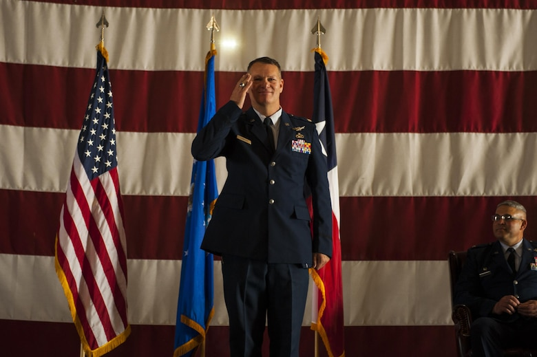 U.S. Air Force Lt. Col. Robert Kammerer, 316th Training Squadron Commander, salutes the 316th TRS for the first time during the 316th TRS Change of Command at the Fire Academy high bay on Goodfellow Air Force Base, Texas, June 30, 2017. The change of command ceremony is a time honored military tradition that signifies the orderly exchange of authority. (U.S. Air Force photo by Senior Airman Scott Jackson/Released)