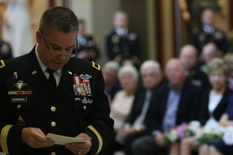 Brig. Gen. Michael Warmack, Chief of Army Reserve Command Operations, Plans and Training, checks his notes during his retirement ceremony at Fort Bragg, N.C., June 29, 2017. Warmack honored  his wife and parents during the ceremony, especially his mother, Toni, who he credits as being an instrumental part of his life. (U.S. Army Reserve photo by Staff Sgt. Felix R. Fimbres)