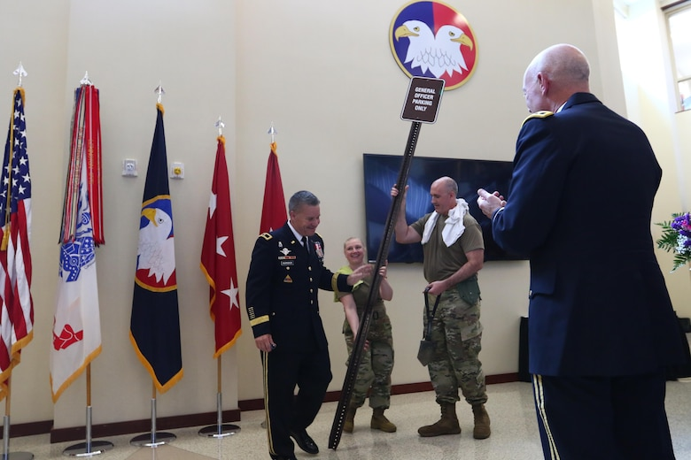 Brig. Gen. Michael Warmack, Chief of Army Reserve Command Operations, Plans and Training, laughs after being presented with a General Officer Parking sign, a gift from his wife, Laura, during his retirement ceremony at Fort Bragg, N.C., June 29, 2017. LTG Charles D. Luckey, Commanding General, U.S. Army Reserve Commandl, was in attendance and praised Warmack for his efforts in the ongoing transformation of the Army Reserve into a lethal and ready force. (U.S. Army Reserve photo by Staff Sgt. Felix R. Fimbres)