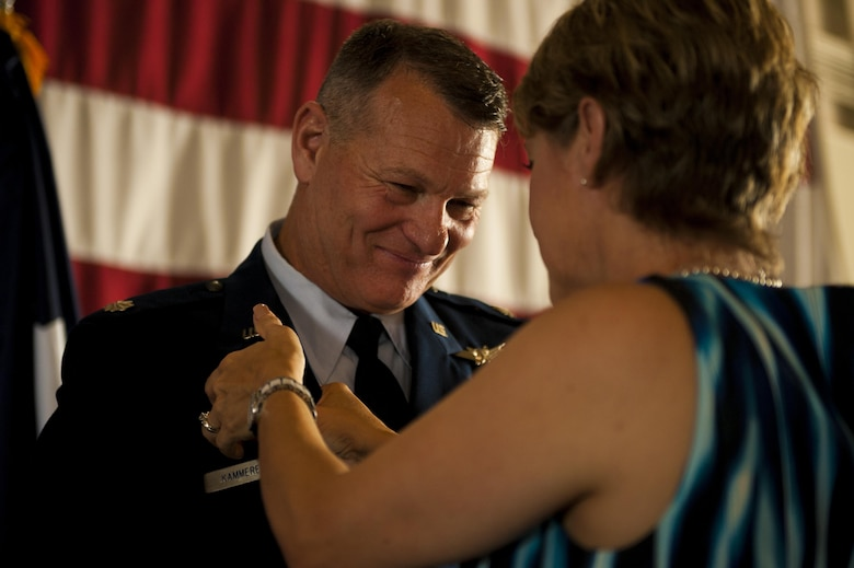 U.S. Air Force Lt. Col. Robert Kammerer, 316th Training Squadron Commander, receives his command pin from his wife Deborah Kammerer during the 316th TRS Change of Command at the Fire Academy high bay on Goodfellow Air Force Base, Texas, June 30, 2017. The command pin signifies a commander of a squadron, group, wing, or major command. (U.S. Air Force photo by Senior Airman Scott Jackson/Released)