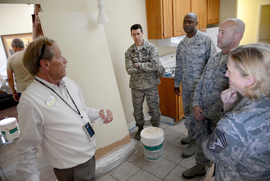 John Seabury, general manager of lodging for the 72nd Force Support Squadron, gives an update on upgrades to the Temporary Lodging Facilities to 72nd Mission Support Group Commander Col. Mark Vitantonio, 72nd Air Base Wing Commander Col. Kenyon Bell, 72nd MSG Vice Commander Lt. Col. Eagle and 72nd ABW Command Chief Master Sgt. Melissa Erb during an immersion tour of several 72nd FSS facilities June 21. The leadership also toured the MPS, Manpower, Honor Guard, CDC South and West, Youth Center, Tinker Club, Airmen and Family Readiness Center, AAFES and Outdoor Rec to gain a better understanding of the general operations, concerns and needs of their facilities. (Air Force photo by Kelly White)