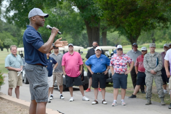 72nd Air Base Wing Commander Col. Kenyon Bell gives remarks and thanks participants during Tinker's 75th Anniversary Golf Tournament June 23.