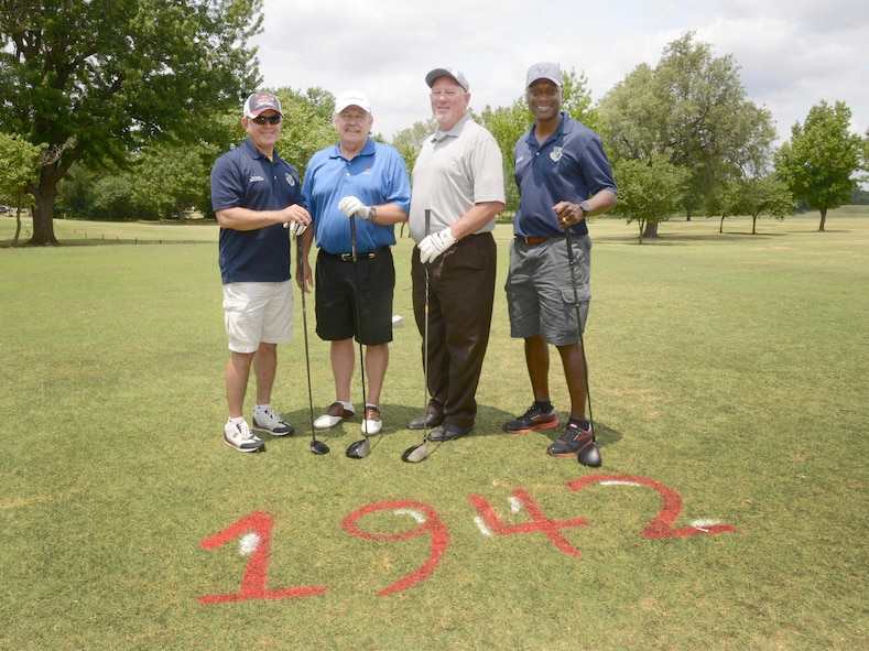 Before they teed off, 72nd Air Base WingDirector of Staff Bob Sandlin, Oklahoma District 42 Senator Jack Fry, Oklahoma State Representative for District 95 Roger Ford and 72nd Air Base Wing Commander Col. Kenyon Bell posed for a quick photo at Tinker's 75th Anniversary Golf Tournament. All holes at the Tinker Golf Course were renamed for the event according to a significant year in Tinker's history. Hole #1 was renamed Hole 1942, signifying the year of the activation of Midwest Air Depot.
