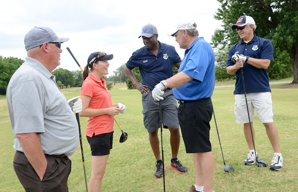 LPGA Golf Pro Stephanie Louden speaks with, from left, Oklahoma State Representative Roger Ford, 72nd Air Base Wing Commander Col. Kenyon Bell, Oklahoma Senator Jack Fry and 72nd Air Base Wing Director of Staff Bob Sandlin during the 75th Anniversary Golf Tournament June 23. Ms. Louden was on hand at one of the holes to make a shot for the teams, which they could then decide to use her ball for the rest of their play or not. She also led several golf workshops over the weekend.