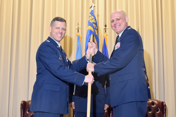 Col. Eric P. DeLange, 688th Cyberspace Wing commander, Joint Base San Antonio-Lackland, Texas, passes the unit guidon to Col. Todd S. Schug, as he assumes command of the 38th Cyber Engineering Installation Group, June 23, 2017, Tinker Air Force Base, Oklahoma. Schug replaces Col. Stan Diamanti who has been reassigned to Colorado. (U.S. Air Force photo/Greg L. Davis)