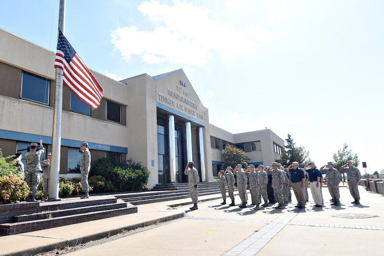 Members of the 72nd Air Base Wing gathered at the Bldg. 460 flag pole June 28 for the final retreat at the historic building. The land that has housed the 72nd ABW headquarters since October 1994 will soon be the new home of a state-of-the art training center for the 552nd Air Control Wing.
