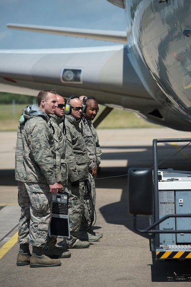 Maintenance Airmen from the 513th Air Control Group watch as an aircraft tow vehicle connects with a U.S. Air Force E-3 Sentry on June 7, 2017, at NATO Air Base Geilenkirchen, Germany. The 513th is providing airborne command and control to BALTOPS 2017, an exercise that involves 50 ships and submarines and 40 aircraft from 14 member nations. (U.S. Air Force photo/2nd Lt. Caleb Wanzer)