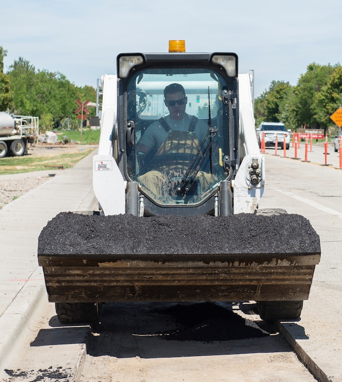 Senior Airman Joshua Hays, 366th Civil Engineer Squadron Dirtboy, prepares to pour asphalt at Mountain Home Air Force Base, Idaho, June 14, 2017. The asphalt is poured at over 300 degrees Fahrenheit. (U.S. Air Force photo by Senior Airman Jessica H. Smith/Released)