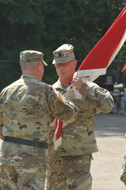 U.S. Army Reserve Command Sgt. Maj. Dennis Law accepts the colors from Brig. Gen. Daniel J. Christian, commander, 412th Theater Engineer Command, during a change of responsibility ceremony at the George A. Morris Army Reserve Center in Vicksburg, Miss., June 10, 2017. Law takes over the Command's top enlisted position from Command Sgt. Maj. Richard Castelveter who retires after more than 35 years of honorable service. (U.S. Army Reserve Photo by Sgt. 1st Class Clinton Wood)