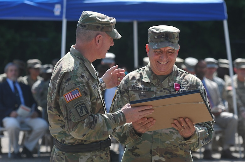 U.S. Army Reserve Command Sgt. Maj. Richard E. Castelveter, senior enlisted adviser of the 412th Theater Engineer Command, right, smiles as he and Brig. Gen. Daniel Christian, acting commander of the Command, share a moment about one of his many retirement awards during a change of responsibility and retirement ceremony at the George A. Morris Army Reserve Center in Vicksburg, Miss., June 10, 2017. Castelveter handed over his duties to Command Sgt. Maj. Dennis E. Law and retires after more than 35 years of honorable service. (U.S. Army Reserve Photo by Sgt. 1st Class Clinton Wood)