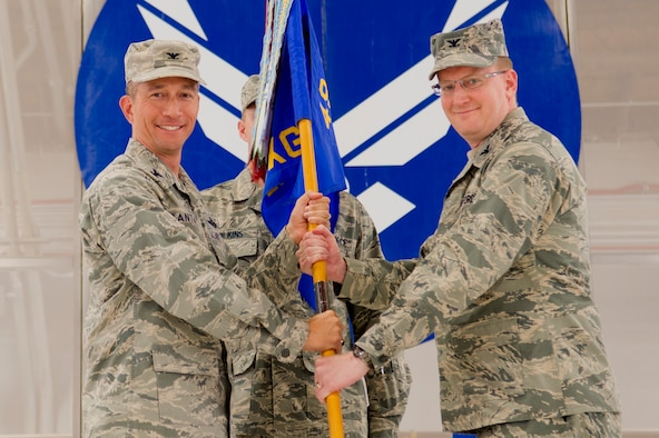 Col. Houston Cantwell, 49th Wing commander, gives the 49th Maintenance Group guidon to Col. Tim Harbor during a change of command ceremony at Holloman Air Force Base, N.M., June 30, 2017. During the ceremony, Col. Harbor took command of the 49th MXG from Col. Lyle Drew, 49th MXG outgoing commander. (U.S. Air Force photo by Tech. Sgt. Amanda Junk)