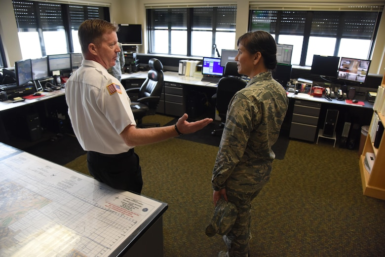Gary Pierson, 81st Infrastructure Division deputy fire chief, provides a tour of the fire department to Col. Debra Lovette, 81st Training Wing commander, during a 81st Mission Support Group orientation tour June 29, 2017, on Keesler Air Force Base, Miss. The tour familiarized Lovette with the group's mission, operations and personnel. (U.S. Air Force photo by Kemberly Groue)