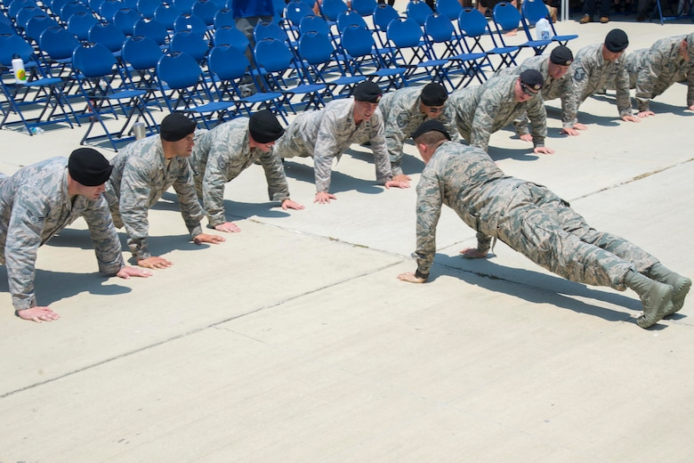 Tactical Air Control Party Airmen perform memorial pushups in honor of fallen Airmen in front of the TAC-P memorial outside the 353rd Battlefield Airmen Training Squadron at the Joint Base San Antonio-Lackland Medina Annex during a memorial ceremony June 23, 2017. The ceremony was held to rededicate the memorial to recognize the innumerable sacrifices made daily by TACP personnel past and present.