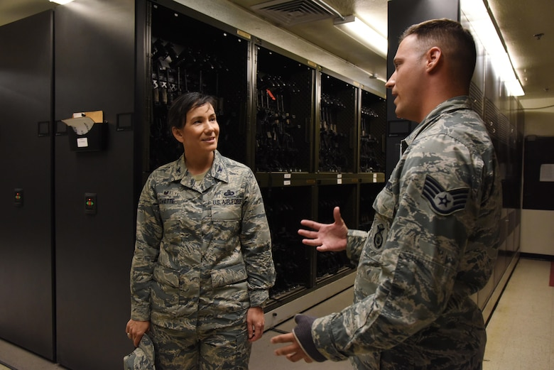 Staff Sgt. Matthew Keel, 81st Security Forces Squadron combat arms instructor, provides a tour of the armory to Col. Debra Lovette, 81st Training Wing commander, at the 81st SFS building during a 81st Mission Support Group orientation tour June 29, 2017, on Keesler Air Force Base, Miss. The tour familiarized Lovette with the group's mission, operations and personnel. (U.S. Air Force photo by Kemberly Groue)