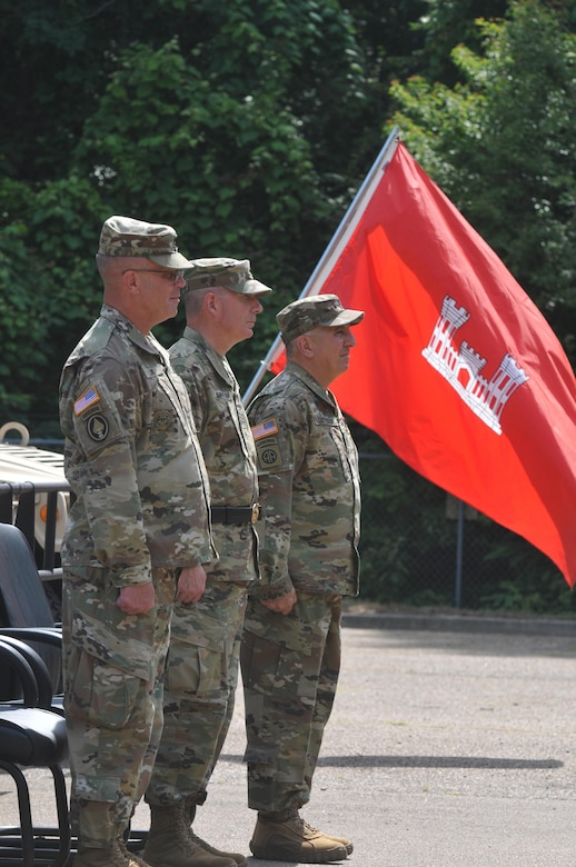 U.S. Army Reserve Command Sgt. Maj. Richard E. Castelveter, right, stands at attention for the last time with other members of the 412th Theater Engineer Command's official party, Command Sgt. Maj. Dennis E. Law, left, and Brig. Gen. Daniel J. Christian, during a change of responsibility and retirement ceremony at the George A. Morris Army Resserve Center in Vicksburg, Miss., June 10, 2017. Christian, acting commander of  the 412th Theater Engineer Command, officiated the ceremony where Castelveter passed the reigns as senior enlisted adviser to Law. Castelveter retires after more than 35 years of honorable service. (U.S. Army Reserve Photo by Sgt. 1st Class Clinton Wood)