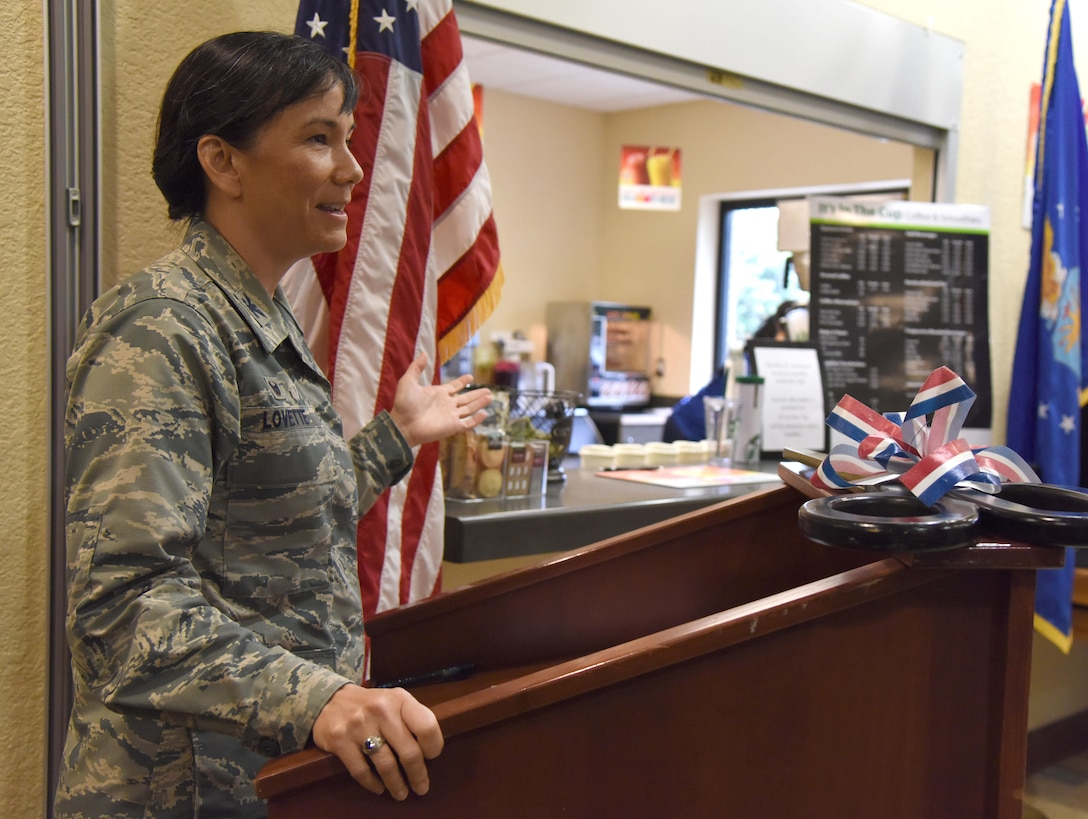 "Col. Debra Lovette, 81st Training Wing commander, delivers remarks during the ""It Is In The Cup"" ribbon cutting ceremony in the Bay Breeze Event Center June 29, 2017, on Keesler Air Force Base, Miss. Keesler's new coffee & smoothie bar serves Starbucks coffee, Frappuccino's, iced beverages and espresso as well as Island Oasis smoothies in a variety of flavors. A full menu of items can be found at www.keesler81fss.us. (U.S. Air Force photo by Kemberly Groue)"