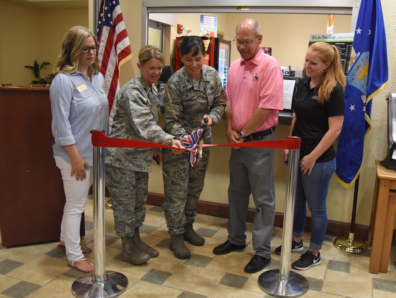 "Lt. Col. Teresa King, 81st Force Support Squadron commander, and Col. Debra Lovette, 81st Training Wing commander, are joined by the 81st FSS community services flight and Bay Breeze golf course members during the ""It Is In The Cup"" ribbon cutting ceremony in the Bay Breeze Event Center June 29, 2017, on Keesler Air Force Base, Miss. Keesler's new coffee & smoothie bar serves Starbucks coffee, Frappuccino's, iced beverages and espresso as well as Island Oasis smoothies in a variety of flavors. A full menu of items can be found at www.keesler81fss.us. (U.S. Air Force photo by Kemberly Groue)"