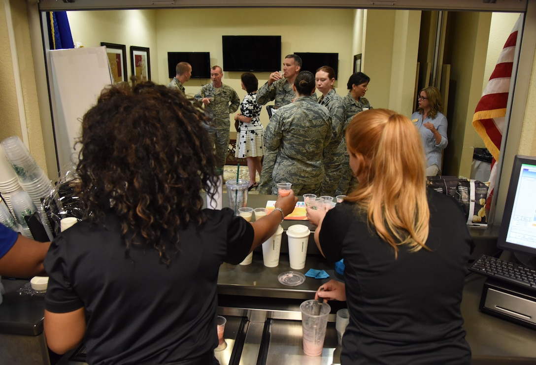 "Members of the 81st Force Support Squadron serve samples to attendees during the ""It Is In The Cup"" ribbon cutting ceremony in the Bay Breeze Event Center June 29, 2017, on Keesler Air Force Base, Miss. Keesler's new coffee & smoothie bar serves Starbucks coffee, Frappuccino's, iced beverages and espresso as well as Island Oasis smoothies in a variety of flavors. A full menu of items can be found at www.keesler81fss.us. (U.S. Air Force photo by Kemberly Groue)"