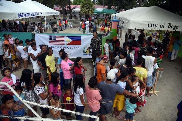 Local community member's form a line outside of a Pacific Angel 2017 health services site in Northern Cebu Province, Bogo City, Philippines, June 26, 2017. PACANGEL is a multilateral humanitarian assistance civil military engagement, which improves military-to-military partnerships in the Pacific while also providing medical health outreach, civic engineering projects and subject matter exchanges among partner forces.