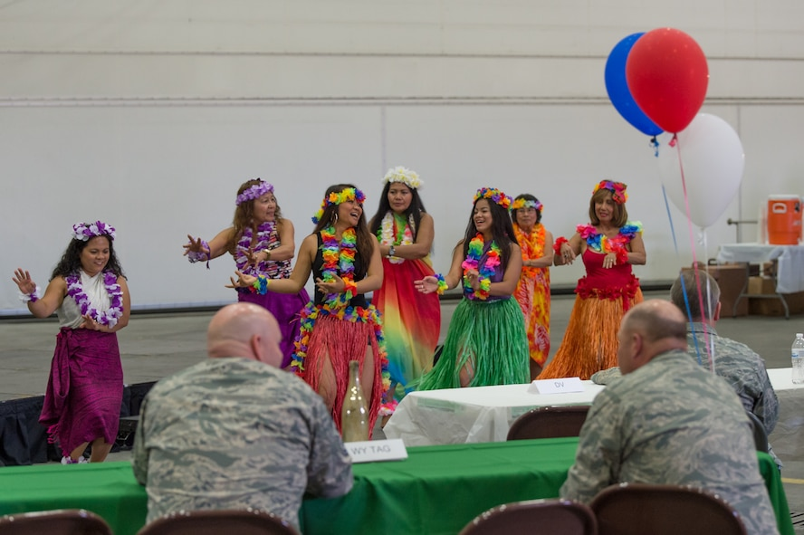 Dancers representing Asian Pacific-Islanders perform during Diversity Day at the Wyoming National Guard's 153rd Airlift Wing. A variety of displays and food highlighted the diversity of culture within the Wyoming Military Department as well as the nation. (U.S. Air National Guard photo/Senior Master Sgt. Charles Delano)