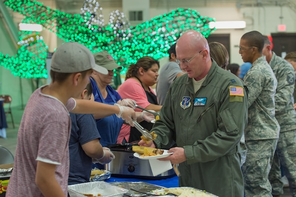 Military and civilians participated in Diversity Day at the Wyoming National Guard's 153rd Airlift Wing. Volunteers provided a variety of cuisine as well as dancing at the celebration. A myriad of displays highlighted the diversity of culture within the Wyoming Military Department as well as the nation. (U.S. Air National Guard photo/Senior Master Sgt. Charles Delano)