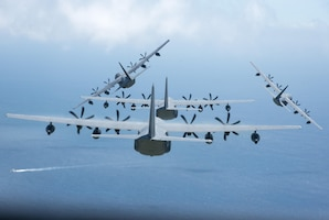 Four U.S. Air Force MC-130J Commando IIs from the 17th Special Operations Squadron execute a simultaneous overhead break June 22, 2017 off the coast of Okinawa, Japan, during a mass launch training mission. Airmen from the 17th SOS conduct training operations often to ensure they are always ready perform a variety of high-priority, low-visibility missions throughout the Indo-Asia-Pacific-Region. (U.S. Air Force photo by Senior Airman John Linzmeier)