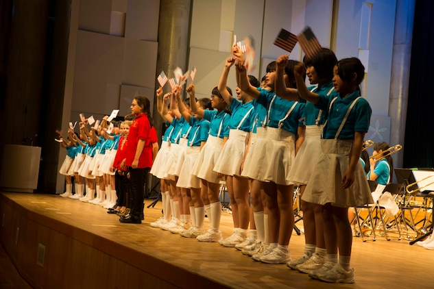 American and Japanese students from Matthew C. Perry Elementary School and Marifu Elementary School take center stage during a performance at the 7th annual U.S.-Japan Friendship Concert at the Sinfonia Iwakuni Concert Hall in Iwakuni City in Japan, Feb. 24, 2017. The concert is a way for the student performers to experience different cultures and communicate with each other through music despite the language barrier. (U.S. Marine Corps photo by Lance Cpl. Gabriela Garcia-Herrera)