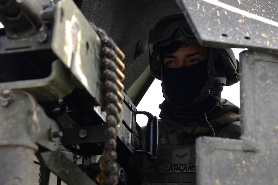 U.S. Air Force Airman 1st Class Bryan Carcamo, 51st Security Forces flight member, stands guard in a Humvee during Exercise Beverly Herd 17-1 at Osan Air Base, Republic of Korea, March 1, 2017. Defenders train and integrate with host nation counterparts to be ready to defend the base and its personnel at all times. (U.S. Air Force photo by Airman 1st Class Gwendalyn Smith)