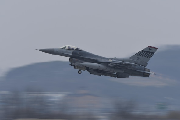 An F-16 Fighting Falcon assigned to the 36th Fighter Squadron takes off for a training mission during Exercise Beverly Herd 17-1 at Osan Air Base, Republic of Korea, March 1, 2017. The exercise provided the fighter Squadrons at Osan the chance to practice a large amount of dynamic firepower training in a short period of time. (U.S. Air Force photo by Staff Sgt. Victor J. Caputo)