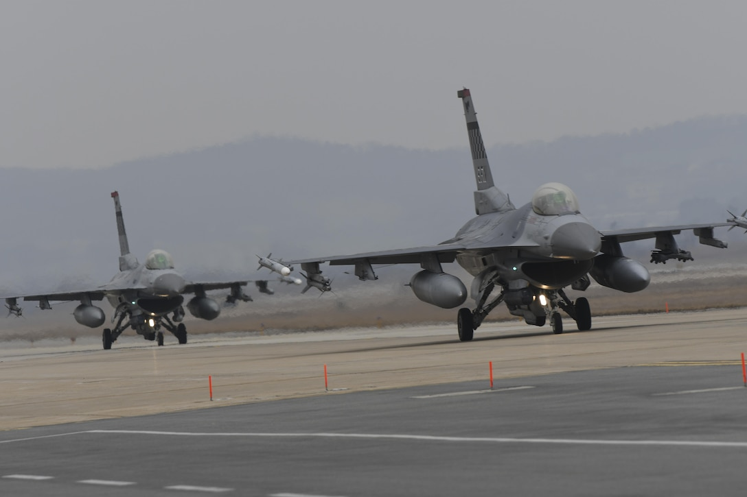 F-16 Fighting Falcons assigned to the 36th Fighter Squadron taxi out for a training mission during Exercise Beverly Herd 17-1 at Osan Air Base, Republic of Korea, March 1, 2017. Exercises like Beverly Herd allow the 51st Fighter Wing to work the muscle movements required to execute and sustain combat operations in the ROK. (U.S. Air Force photo by Staff Sgt. Victor J. Caputo)