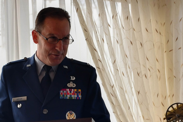Col. Scott Arcuri, U.S. Air Forces in Europe directorate of manpower, personnel, and services, speaks at a dual retirement ceremony on Ramstein Air Base, Germany, Feb. 24, 2017. John and Colynn Hamilton, USAFE management analyst and human resources specialist respectively, as well as husband and wife, retired after serving more than 80 years combined as government employees. (U.S Air Force photo by Senior Airman Tryphena Mayhugh)