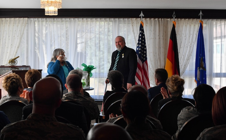 Colynn and John Hamilton, U.S. Air Forces in Europe human resources specialist and management analyst respectively, speak during their dual retirement ceremony on Ramstein Air Base, Germany, Feb. 24, 2017. After over 80 years of combined service, the Hamiltons retired to spend time with their five kids and 12 grandchildren. (U.S Air Force photo by Senior Airman Tryphena Mayhugh)