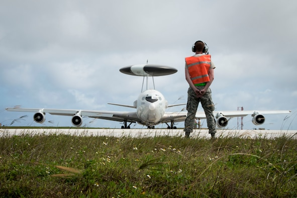U.S. Air Force Senior Airman Austin Perry from the 962nd Aircraft Maintenance Unit prepares to marshal an E-3 Sentry from the 961st Airborne Air Control Squadron during annual exercise Cope North Feb. 23, 2017, at Andersen Air Force Base, Guam. The exercise provides opportunities for Airmen from different units and nations to train and work with each other's airframes. The Sentry has rotating radar that has a range of more than 250 miles, providing early warning and detection for missions. (U.S. Air Force photo by Senior Airman John Linzmeier)