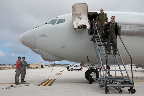Canadian and U.S. Airmen from the 961st and 962nd  Airborne Air Control Squadrons exit an E-3 Sentry from the 961st Airborne Air Control during annual exercise Cope North Feb. 23, 2017, at Andersen Air Force Base, Guam. Members of the Canadian Air Force are operating within the 962nd AACS from Elmendorf Air Force Base, Alaska, as part of an exchange program. Cope North is being held to provide opportunities for 22 flying units from U.S. Pacific Command, the Royal Australian Air Force and the Japan Air Self-Defense Force to train together, increase interoperability and improve their effectiveness at stabilizing the Indo-Asia-Pacific region. (U.S. Air Force photo by Senior Airman John Linzmeier)